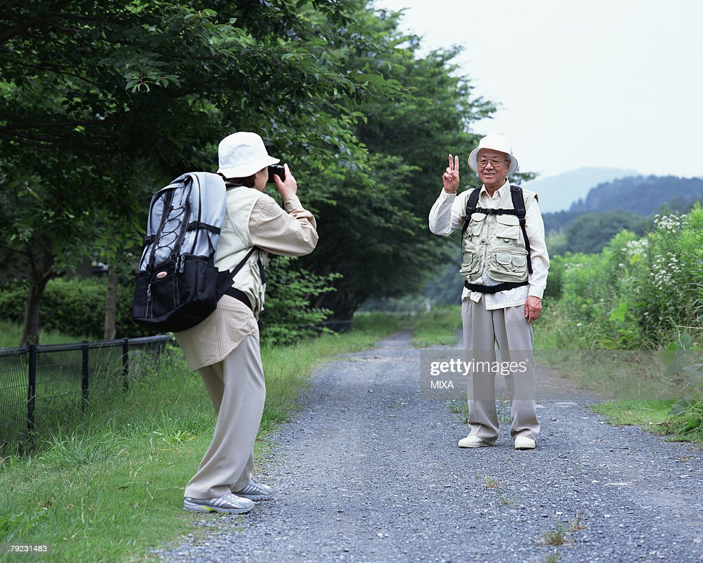 A senior couple taking a picture : Stock Photo