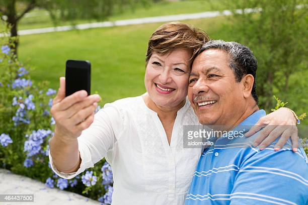 Senior couple taking a selfie