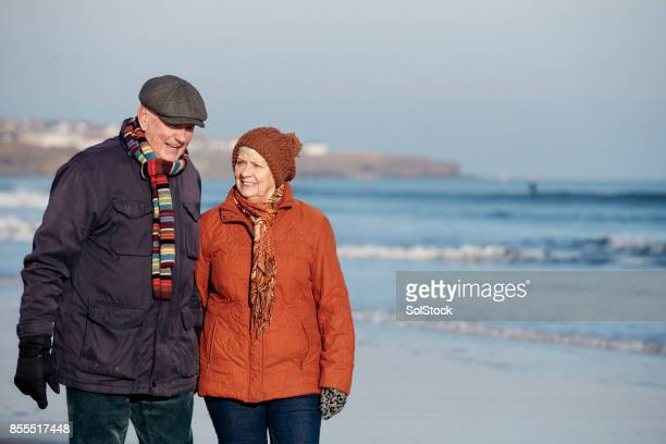 Senior Couple Taking a Walk Along the Beach