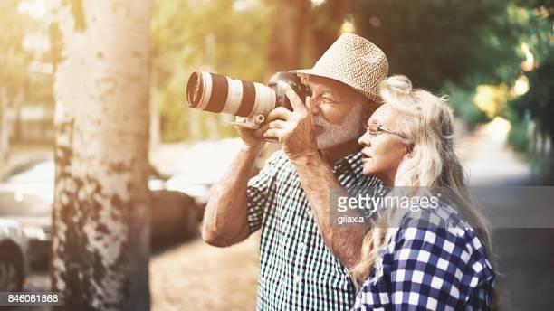 Senior couple taking photos of nature.
