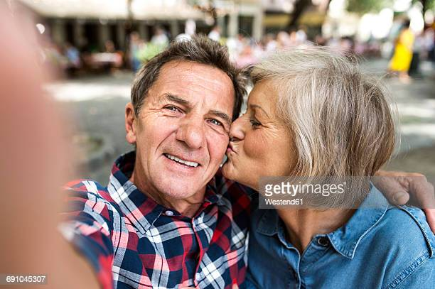 Senior couple taking selfie with smartphone