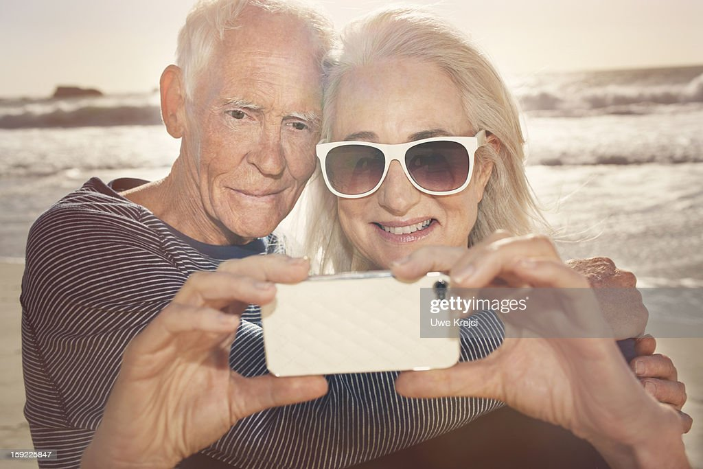 Senior couple taking self-portrait with phone : Stock Photo