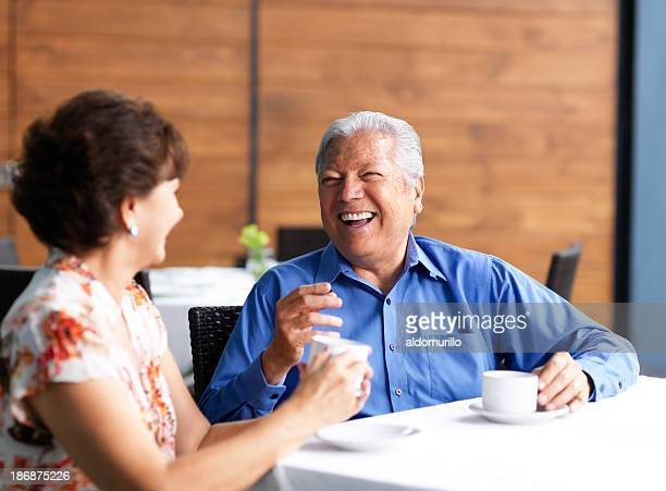Senior couple talking in a restaurant