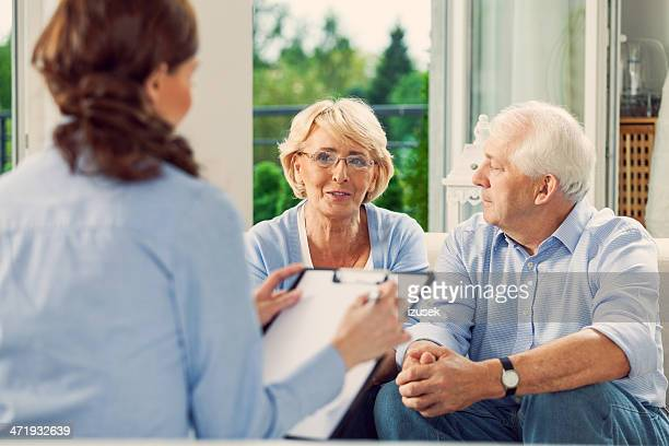 Senior couple talking with insurance agent