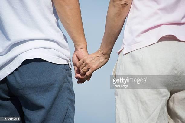 Senior Couple Touching Hand