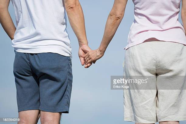 Senior Couple Touching Hand