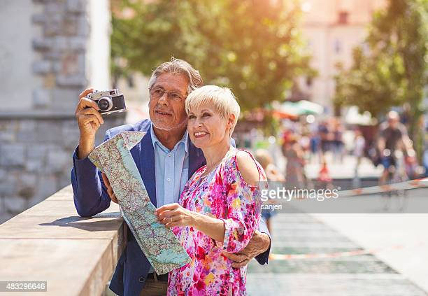 Senior couple tourists at the city