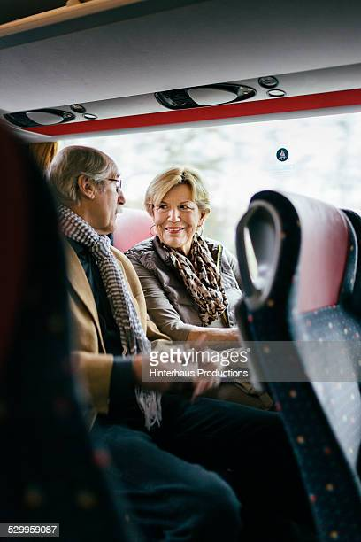 Senior Couple Travilling With Bus
