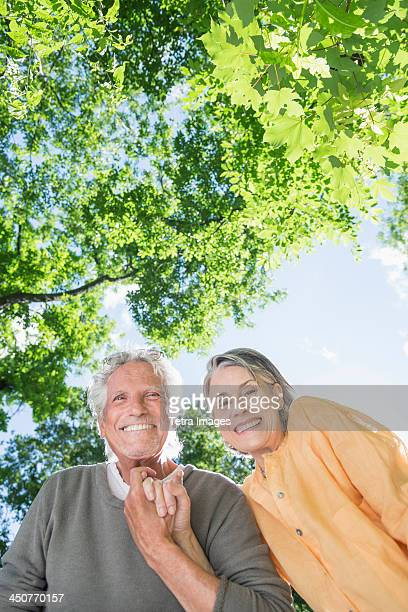 Senior couple under trees