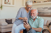 Elderly couple with smart phone in their hands