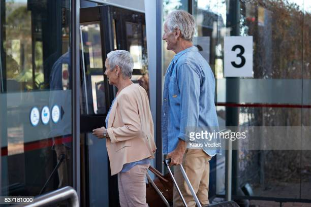Senior couple, waiting for a bus, at public transport station