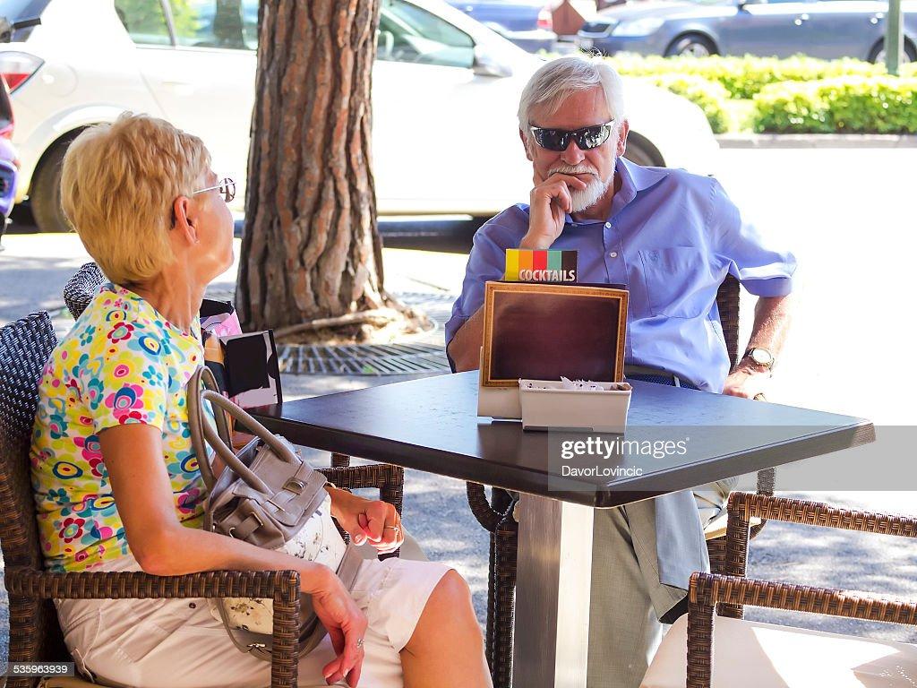 Senior couple waiting to order : Stock Photo