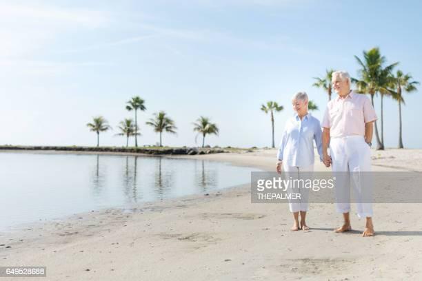 Senior couple walking at the beach