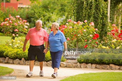 Senior Couple Walking in a Park : Stock Photo