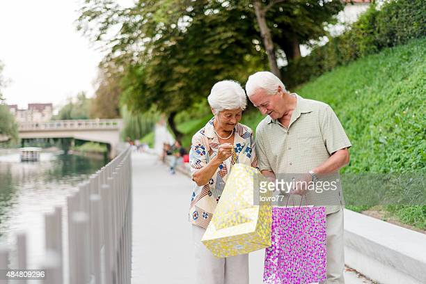Senior couple walking in city center