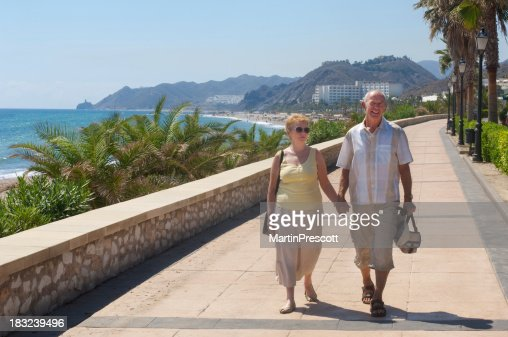 senior couple walking on holiday or are they expatriates