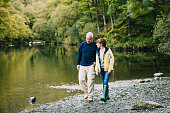 Senior couple are nejoying a walk around the Lake District together.