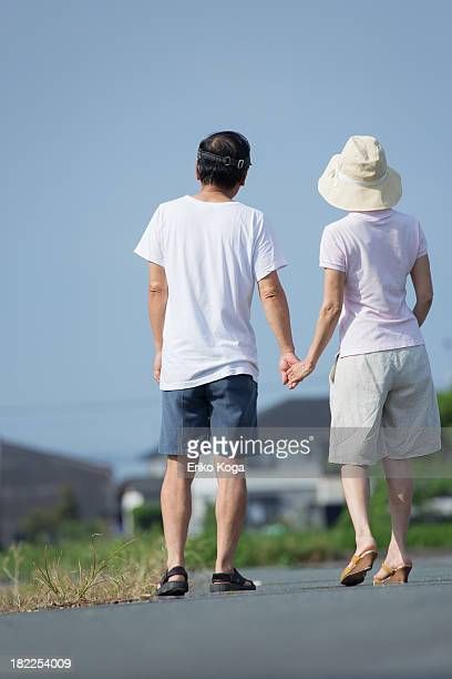 Senior Couple Walking Together on Road