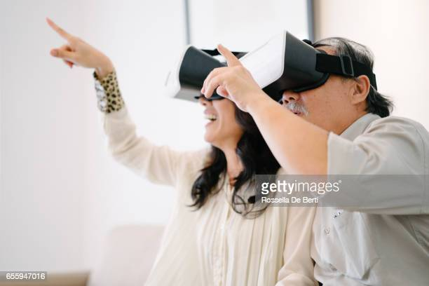 Senior couple wearing virtual reality headset