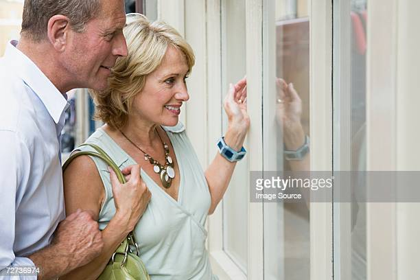 Senior couple window shopping