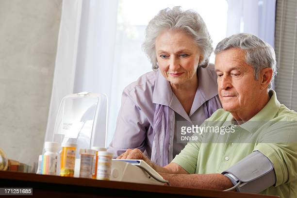 Senior couple with medications