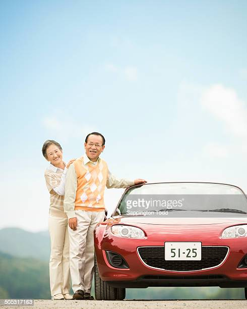 Senior Couple With Red Car