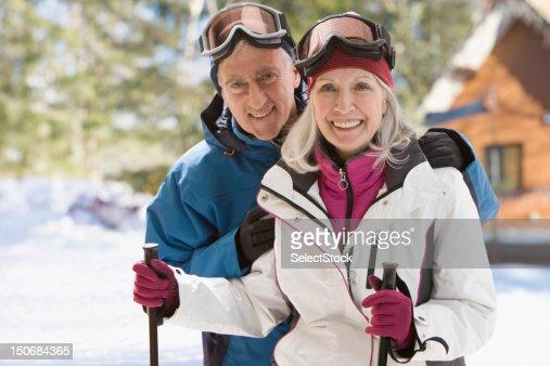 Senior couple with ski gear