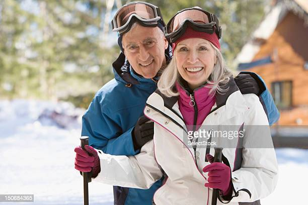 Senior couple with ski gear