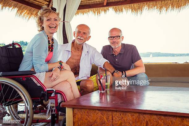 senior couple with woman in wheelchair