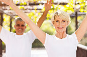 healthy senior couple working out outdoors