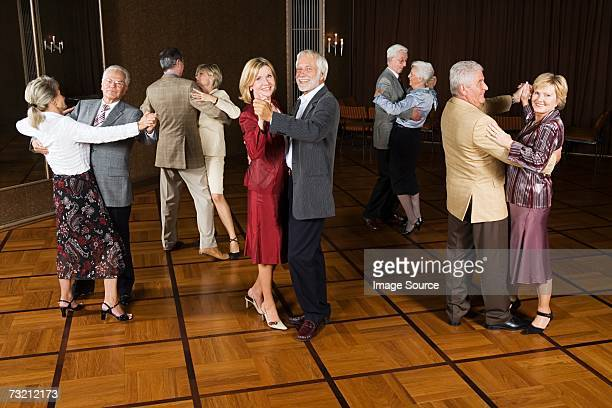 Senior couples dancing