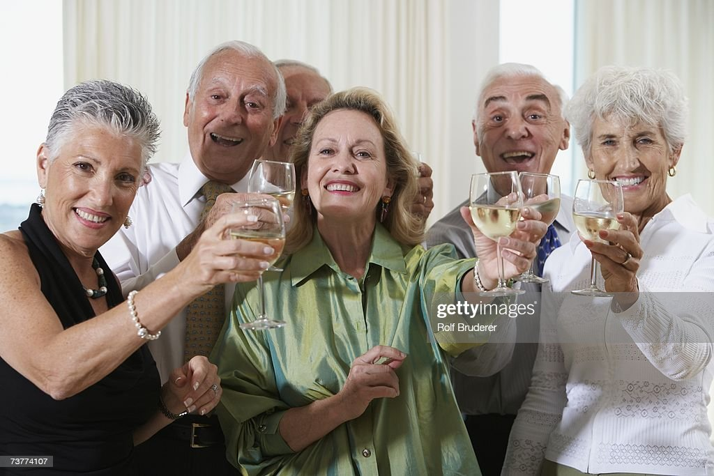 Senior couples toasting at party : Stock Photo