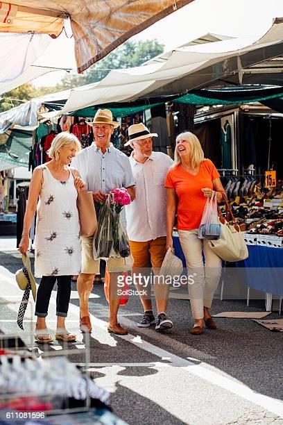 Senior Couples Vistiting an Outdoor Market