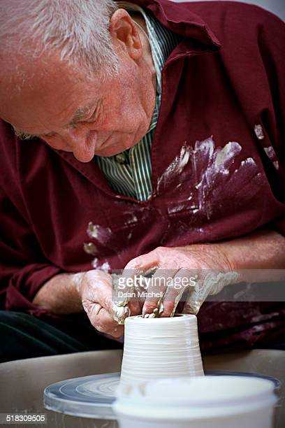 Senior craftsman working on a pottery wheel