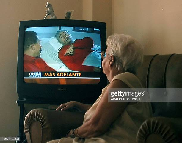 A senior Cuban citizen watches 14 August 2006 a video released by the stateowned Cuban television showing Cuban leader Fidel Castro recovering from...