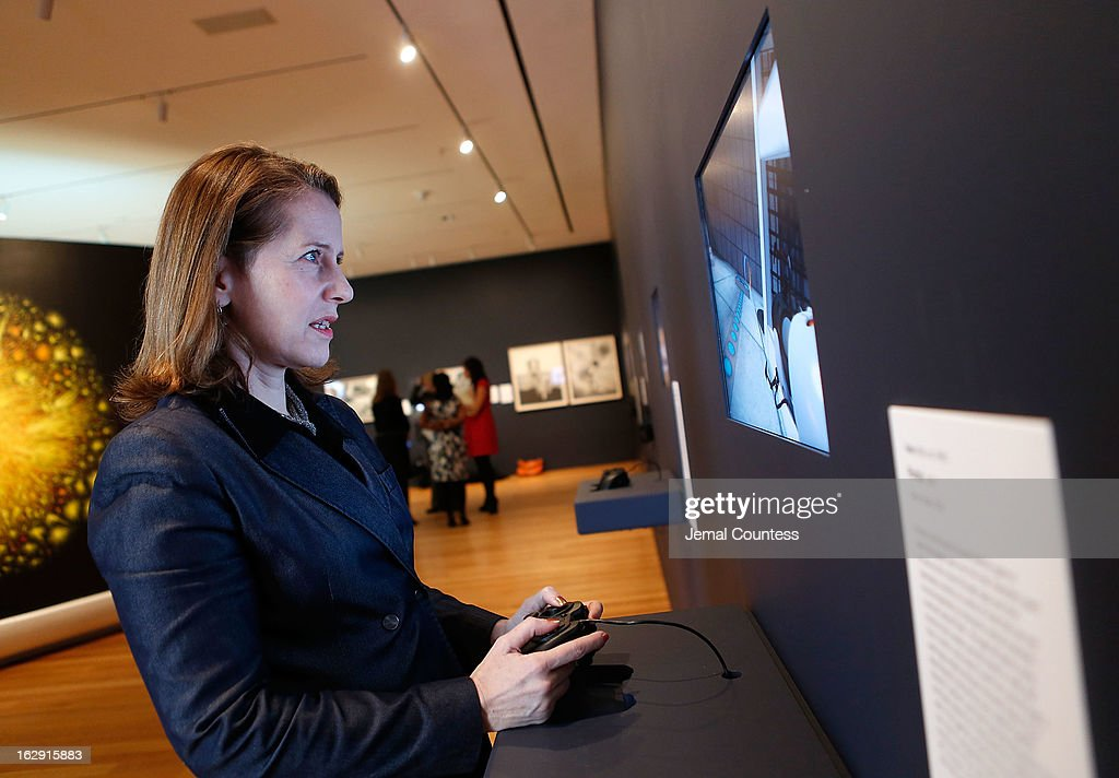 Senior curator at the Museum of Modern Art and exhibit organizer Paola Antonelli plays 'Portal' which is one of the 14 video games that are part of the exhibiton 'Applied Designs' during the 'Applied Design' press preview at The Museum of Modern Art on March 1, 2013 in New York City.