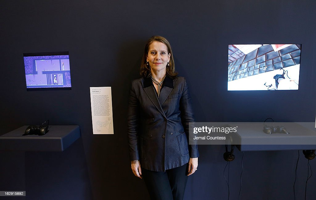 Senior curator at the Museum of Modern Art and exhibit organizer Paola Antonelli stands by two of the 14 video games that are part of the exhibiton 'Applied Designs' during the 'Applied Design' press preview at The Museum of Modern Art on March 1, 2013 in New York City.