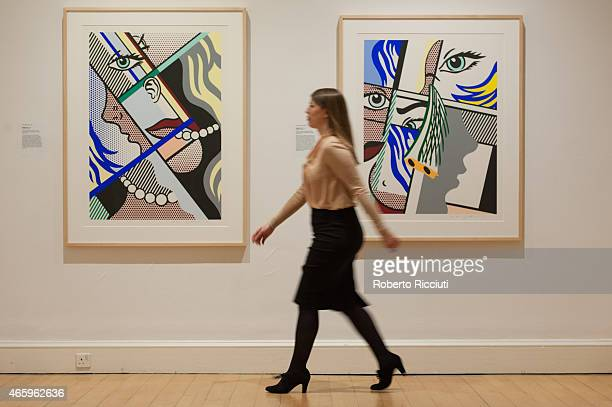 Senior Curator Lucy Askew walks in front of some Lichtensteins artworks during a press view of ARTIST ROOM Roy Lichtenstein at the Scottish National...