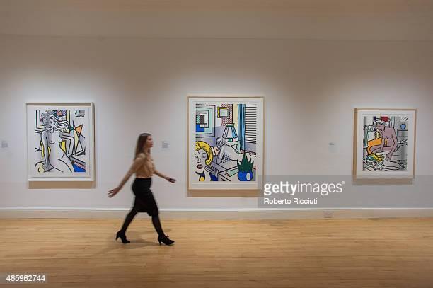 Senior Curator Lucy Askew walks in front of some Lichtenstein's artworks during a press view of ARTIST ROOM Roy Lichtenstein at the Scottish National...