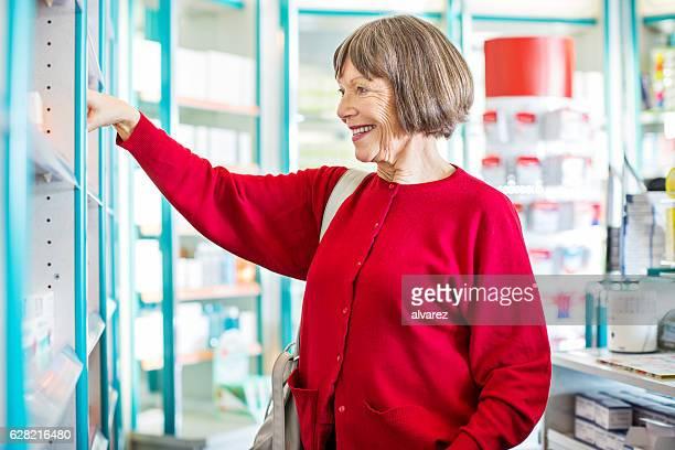 Senior customer buying medicine at drugstore
