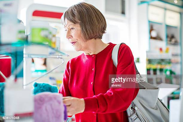 Senior customer buying medicine at pharmacy