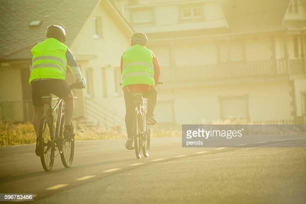 Senior cyclist on a misty road.