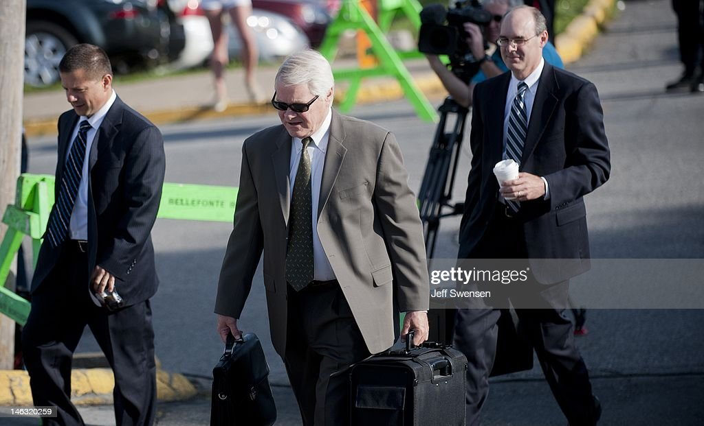 Senior Deputy Attorney General Joseph McGettigan III arrives at the Centre County Courthouse before presenting witnesses at the fourth day of testimony in the Jerry Sandusky child sex abuse trial on June 14, 2012, in Bellefonte, Pennsylvania. Sandusky is charged with 52 criminal counts of alleged sexual abuse of children.
