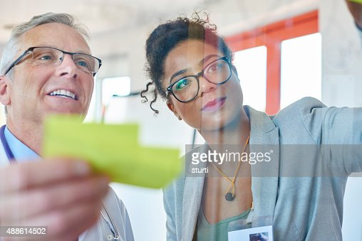 senior doctor and businesswoman brainstorming