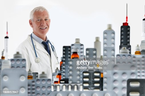 Senior doctor and cityscape of prescription pills : Stock Photo