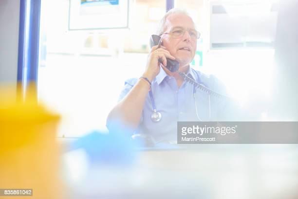 Senior doctor calling up for test results
