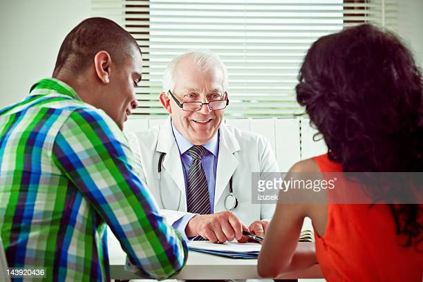 Senior doctor explaining medical results