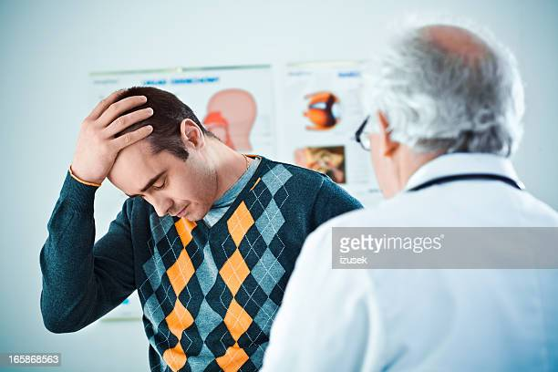 Senior doctor giving bad news
