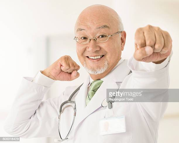Senior Doctor Punching In Air