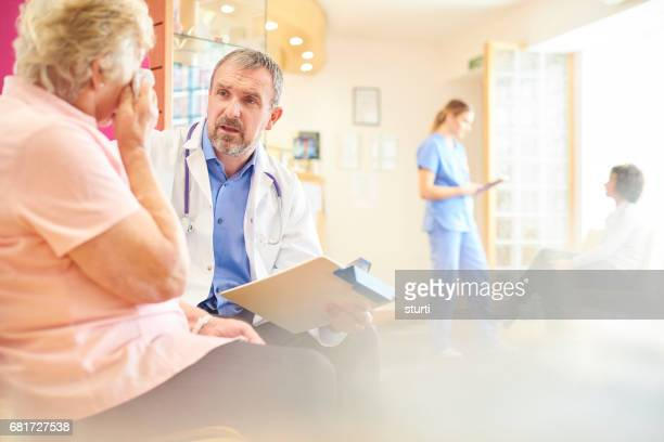 Senior doctor re-assuring patient